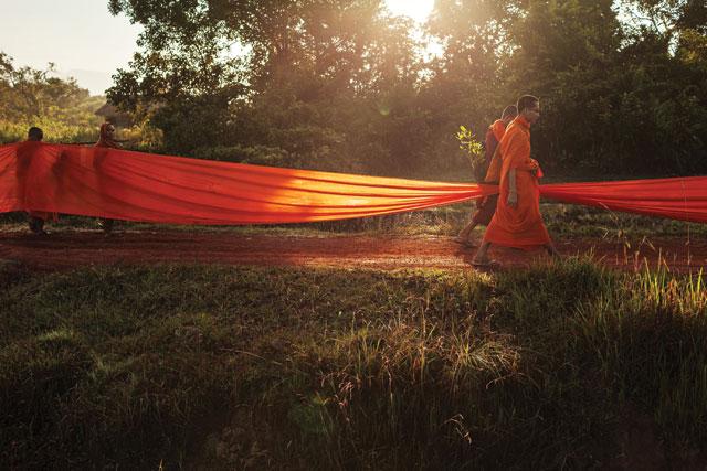 Colouring the debate: monks carry a saffron robe through a Cambodian village to raise awareness of environmental destruction. Thomas Cristofoletti