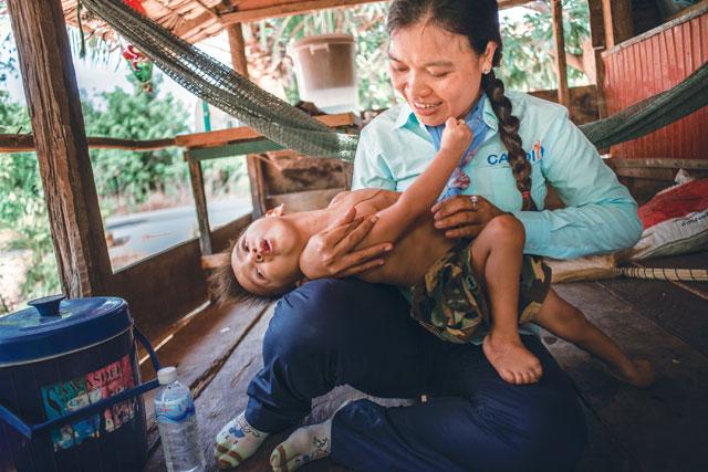 Phearom visits her regular patient, three-year-old Lihour Srean. Photo: Anna Spelman