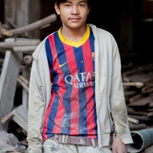 """Noey Savoeun, 22, construction worker. Savoeun moved to Phnom Penh from rural Svay Rieng province five years ago, and he now lives at the construction site where he works. """"The working conditions here are normal, no one has been hurt,"""" he said, adding that he wants to farm, to raise animals and a family. When asked about trade unions, he said he doesn't know what they are. After an explanation, he said: """"It's a good idea, I'd like to join if there was one"""". Photo: Francis Wilmer for SEA Globe"""
