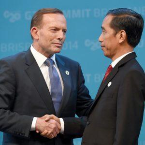G'day, mate: Australian Prime Minister Tony Abbott (left) shakes hands with President Joko Widodo of Indonesia at the 2014 G20 summit in Brisbane