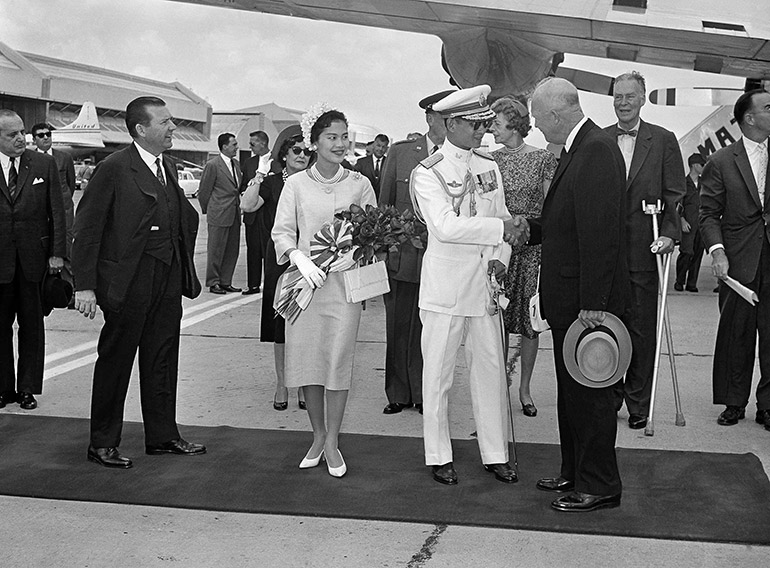 President Dwight Eisenhower gives a welcoming hand to King Bhumibol Adulyadej at Washington National Airport, June 28, 1960 as the American born head of Thailand and his Queen arrive for a five-day state visit.