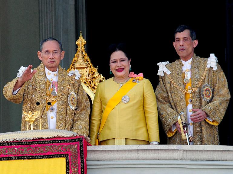 A Royal Household Bureau handout photo shows Thai King Bhumibol Adulyadej (L) waves next to his wife Queen Sirikit (C) and Thai Crown Prince Maha Vajiralongkorn (R) during an audience to mark his 80th birthday celebration on the balcony of the Chakri Maha Prasat Throne Hall at the Grand Palace, Bangkok, Thailand, 05 December 2007.