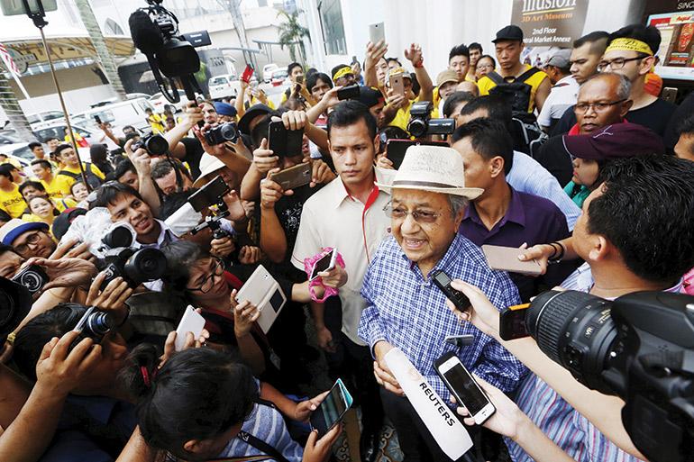 Former Prime Minister Mahathir Mohamad speaks at a 2015 Bersih rally