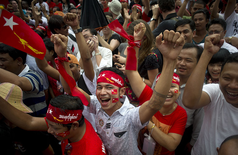 NLD supporters celebrate as election results are broadcast on a giant screen outside party headquarters in Yangon in November 2015