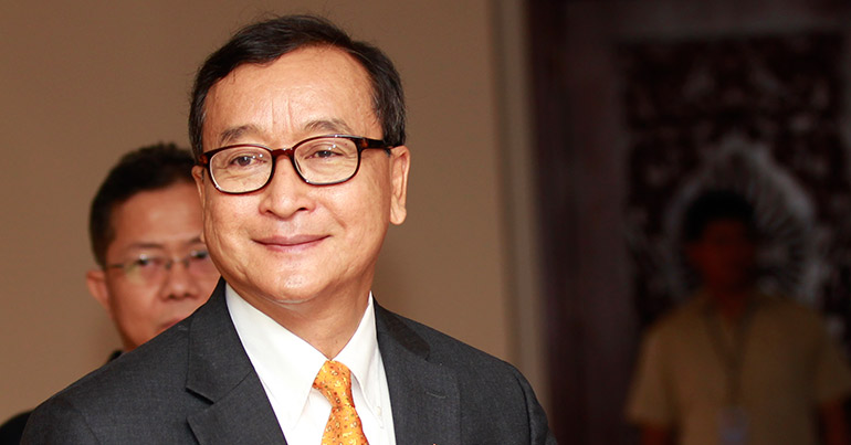Sam Rainsy, President of the opposition Cambodia National Rescue Party (CNRP), arrives at the National Assembly during a session in Phnom Penh, Cambodia