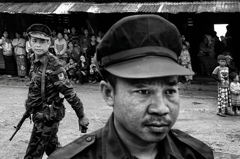 Ta'ang National Liberation Army soldiers explain to Ta'ang villagers why they are fighting with the Shan State Army, another ethnic armed group