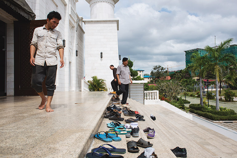 worshippers exit Al-Serkal Mosque in Phnom Penh after the day's noon prayers