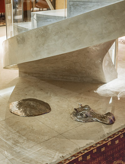 Heinecke's penthouse includes such wonders as an abstract silver hippopotamus