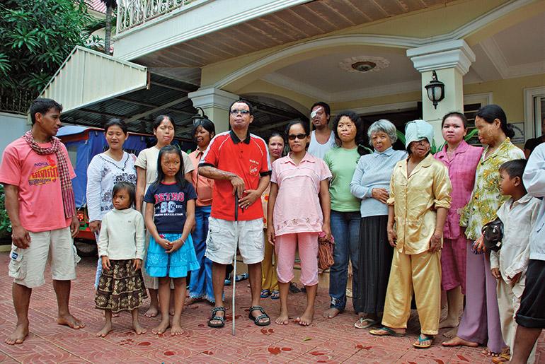 Acid attack survivors gather in front of the CASC centre in Phnom Penh in 2009. Photo: Sam Jam
