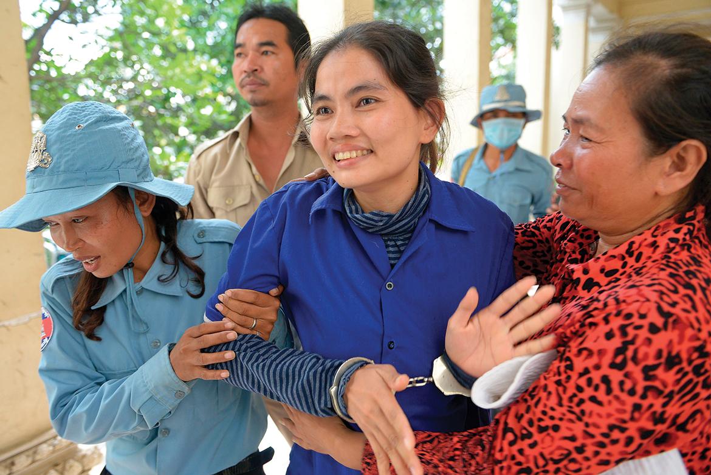 A woman hugs Boeung Kak activist Yorm Bopha outside the appeals court in Phnom Penh