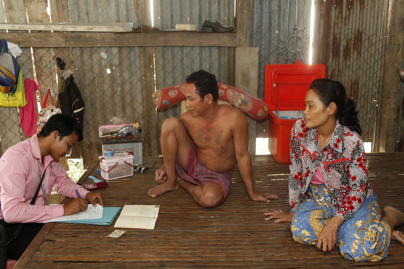 Chamroeun microfinance loan officer Chin Sokreth at a client's home in Cambodia