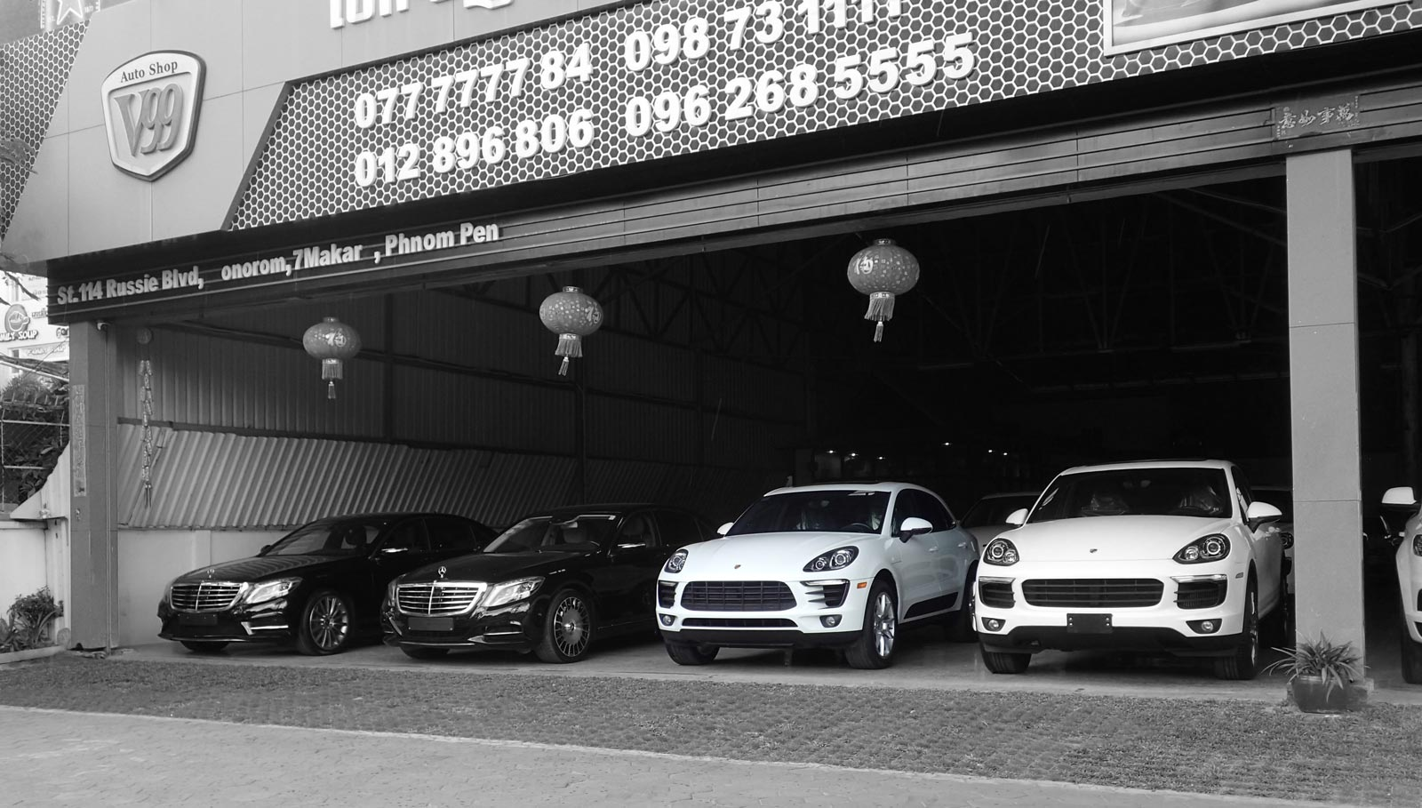 Luxury cars sit on the lot at Auto Shop V99. Photo: Amanda Kaufmann