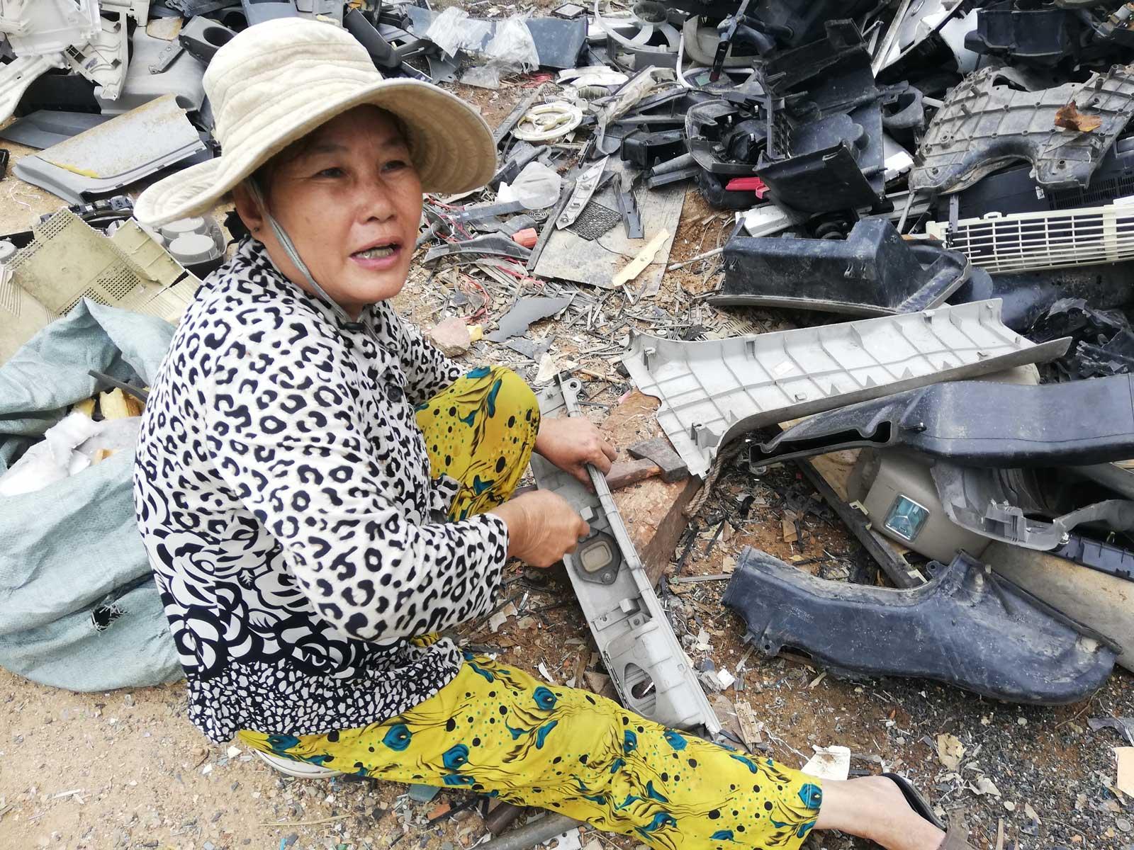Phnom Penh recycler Mae Kamouy preparing plastic for reuse. Photo: Evie Breese