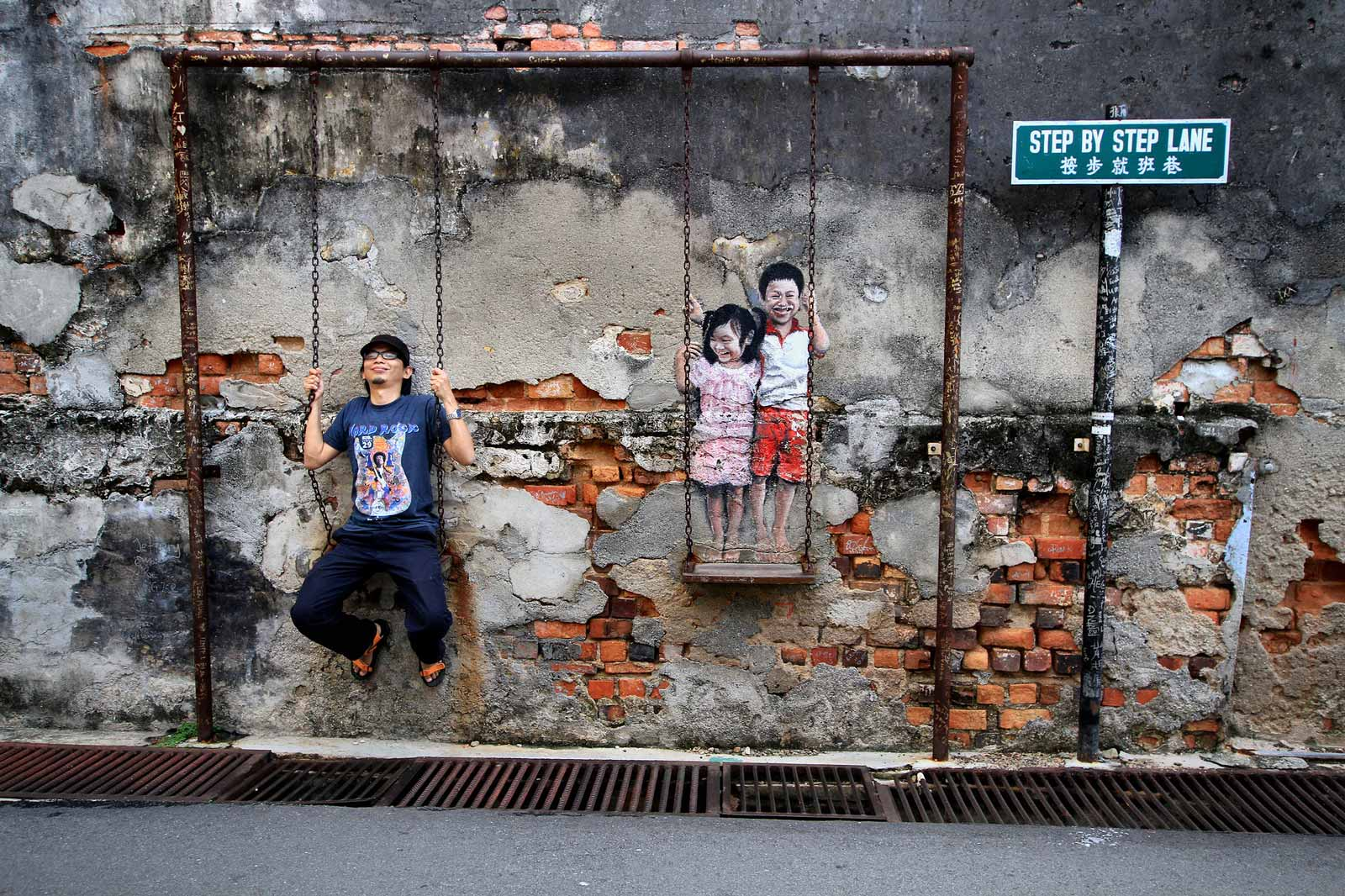 Children On A Swing, another famous piece of George Town street art. Photo: Mohd Fazlin / Flickr creative commons