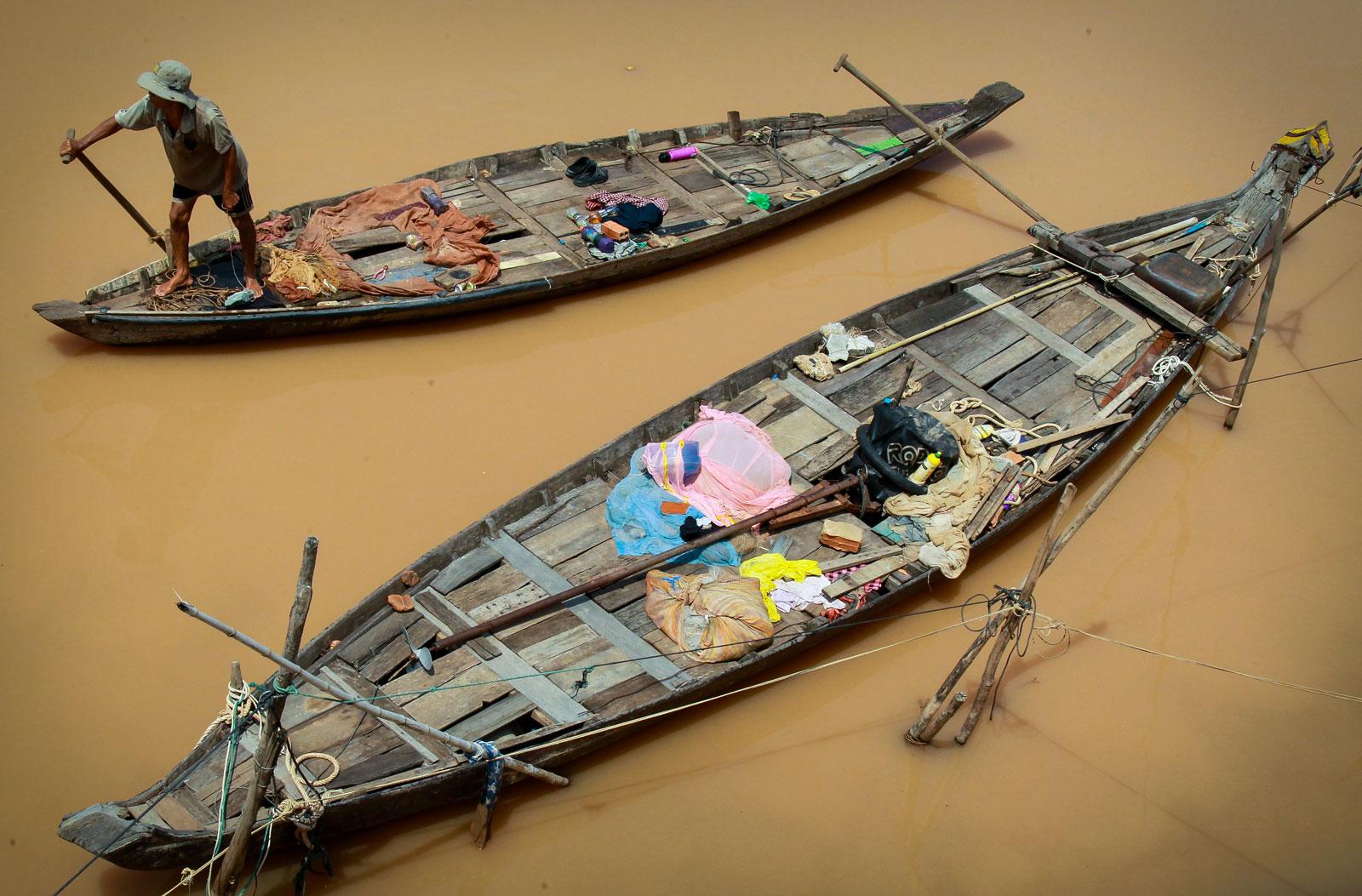A fisherman on the Mekong River in Phnom Penh. Photo: EPA/Mak Remissa