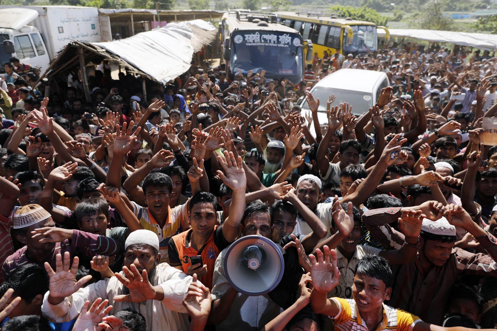Rohingya refugees shout slogans during a protest against a disputed repatriation programme at the Unchiprang refugee camp near Teknaf, Bangladesh, 15 November 2018. Photo: EPA-EFE/K M Asad