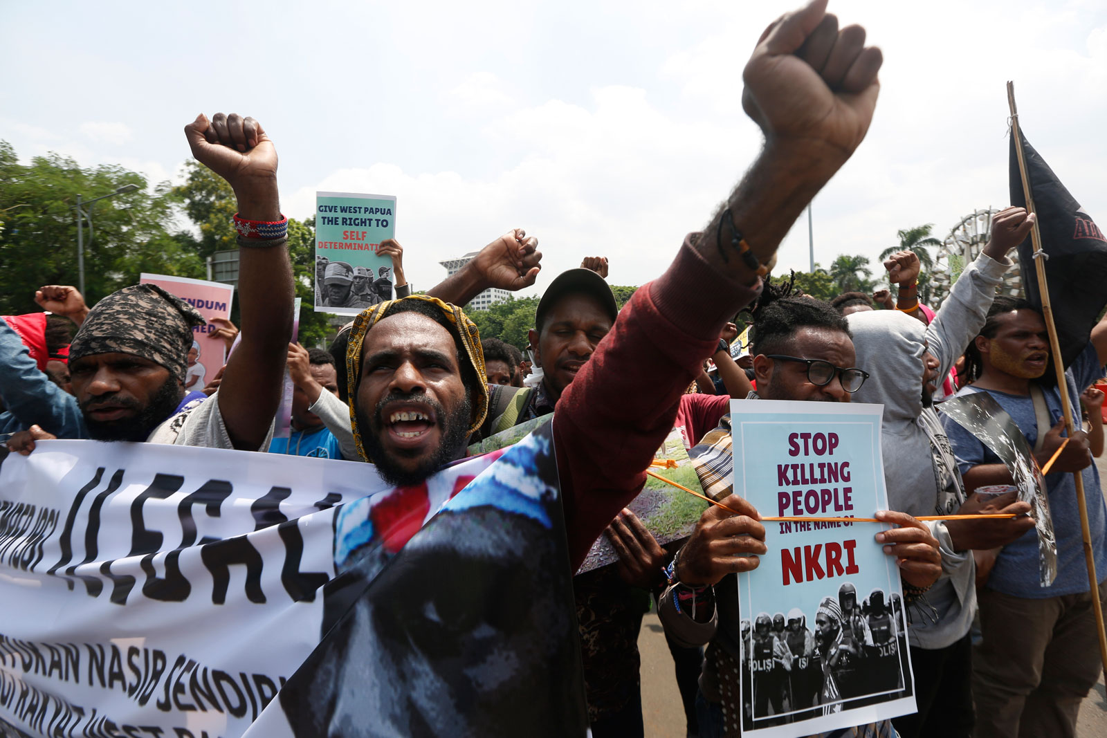 West Papuan activists shout anti-Indonesia slogans during a rally at a main street in Jakarta, Indonesia, 19 December 2018. Dozens of West Papuan activists staged a rally demanding the right to self-determination for West Papua. EPA-EFE/ADI WEDA