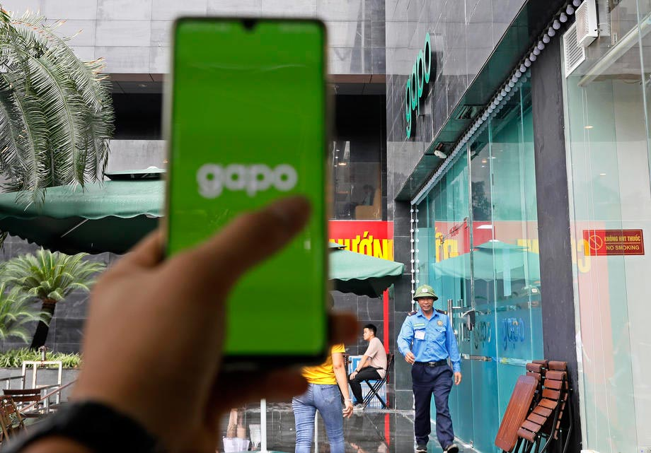 Person shows the opening screenshot of new social networking site Gapo, in a café in Hanoi on 1 August 2019. Gapo aims to have three million users by the end of 2019 and 50 million by 2021. Photo: EPA-EFE/Ming Hoang