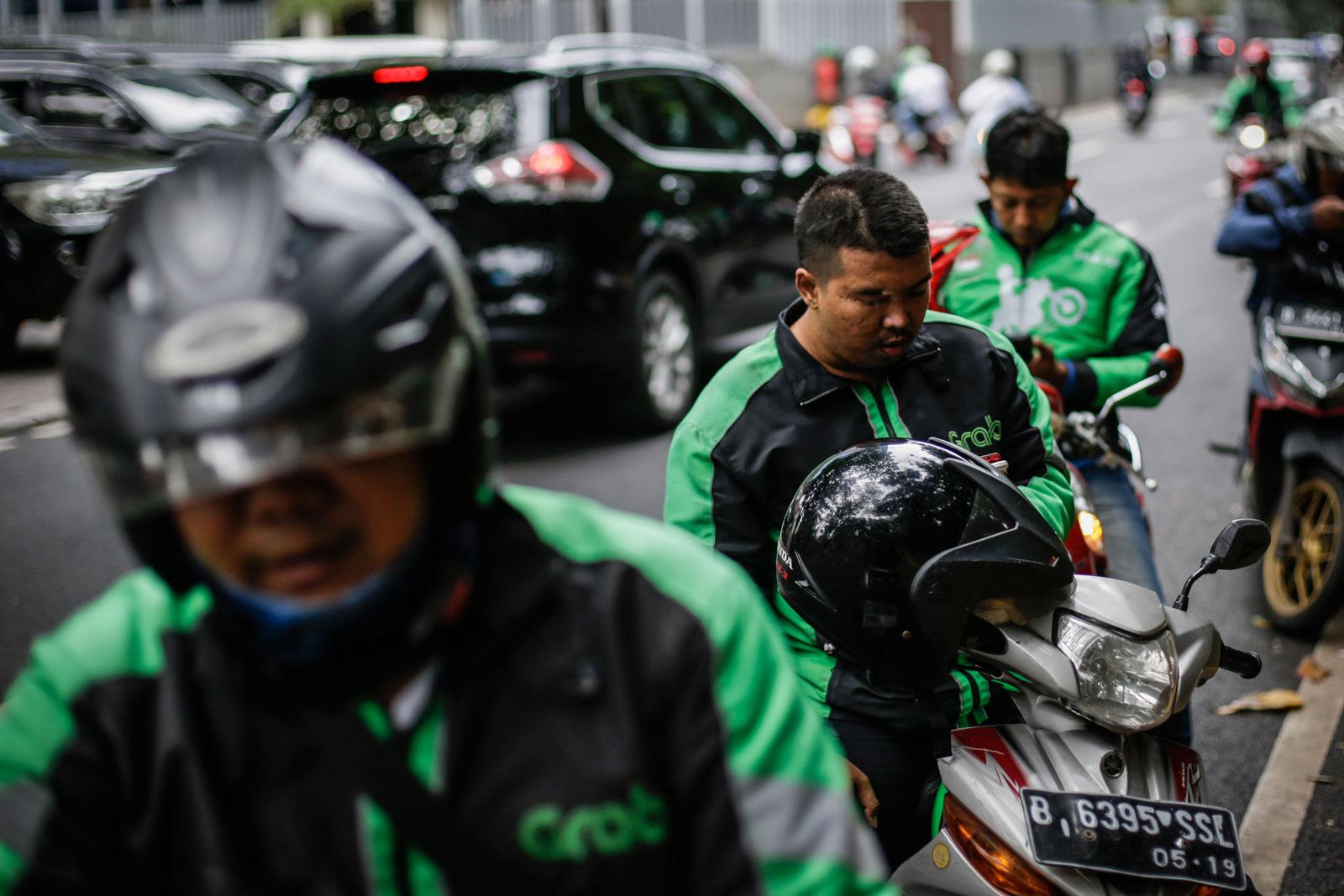 Gojek drivers seen in Jakarta in December 2017. Photo: EPA/Mast Irham