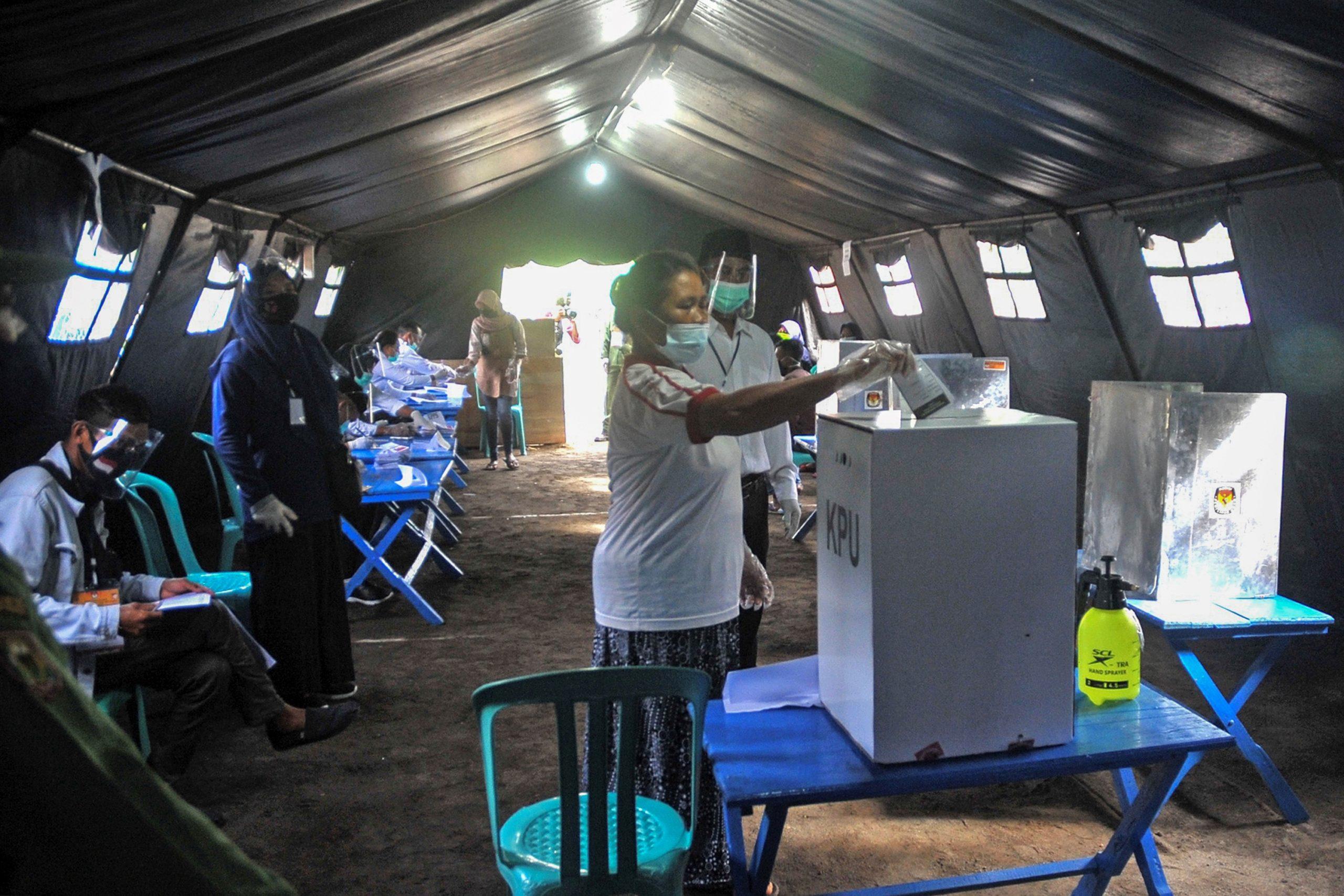 Indonesia holds nationwide poll despite virus warnings